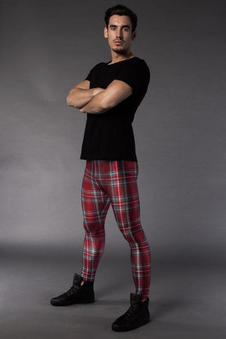 Man posing in Kapow Meggings red tartan coloured men's leggings