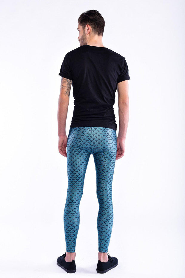 Man posing in Kapow Meggings metallic blue fish scales men's leggings from behind