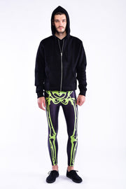 Man posing in Kapow Meggings neon green skeleton men's legging