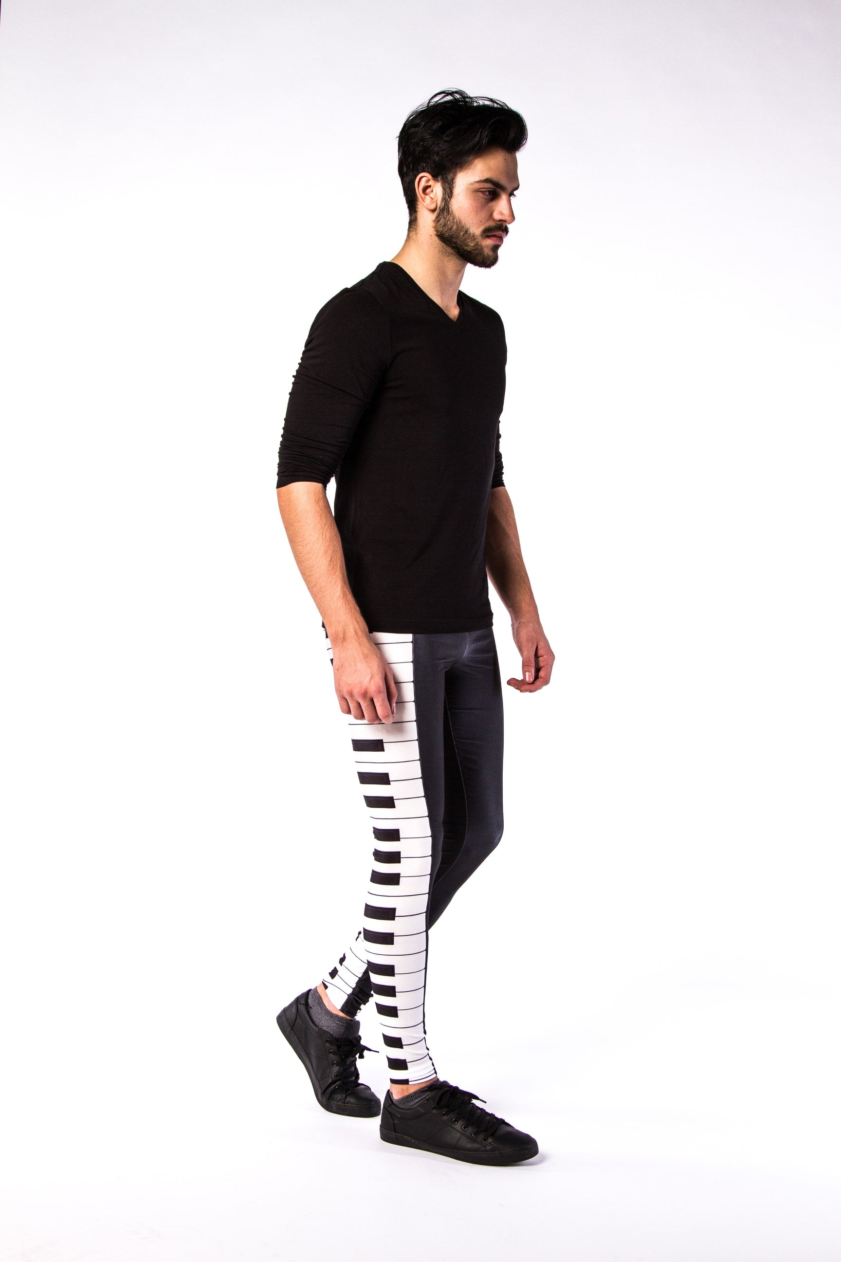 0c53117642632f Man posing in Kapow Meggings Black and White piano key men's leggings one  side view