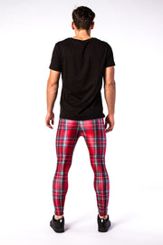 Man posing in Kapow Meggings red tartan coloured men's leggings from behind