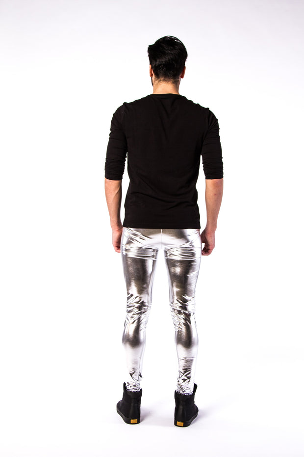 Man posing in Kapow Meggings silver metallic men's leggings from behind