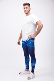man wearing blue lightning leggings left