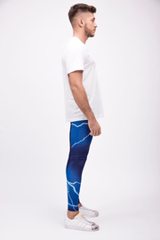 man wearing blue lightning leggings side