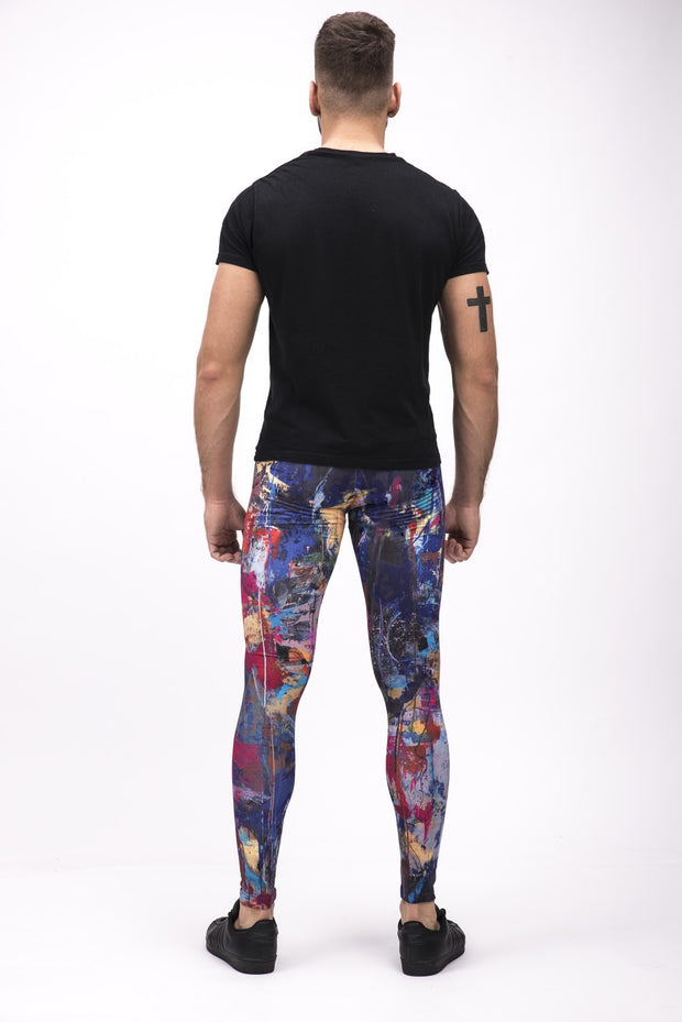 man wearing dark multi color leggings back