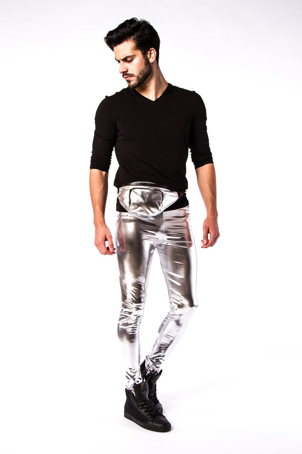 man wearing silver bullet meggings and silver bullet fanny pack