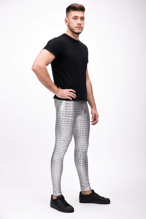 man wearing silver holographic leggings right