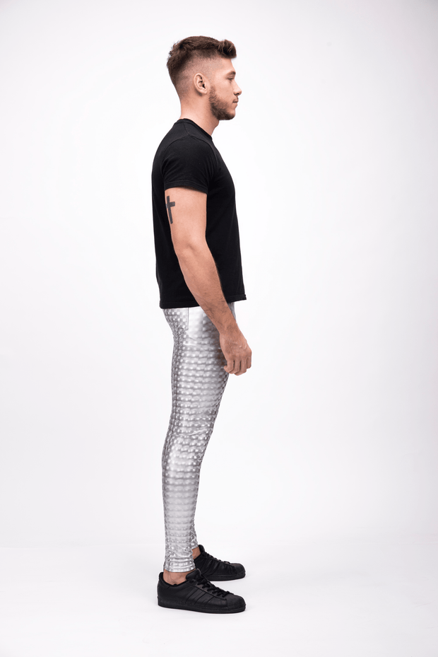 man wearing silver holographic leggings side