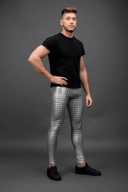 man posing wearing silver holographic leggings