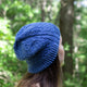 Quist Hat by Melanie Berg shown in a blue color from our New England Fingering Wool yarn line