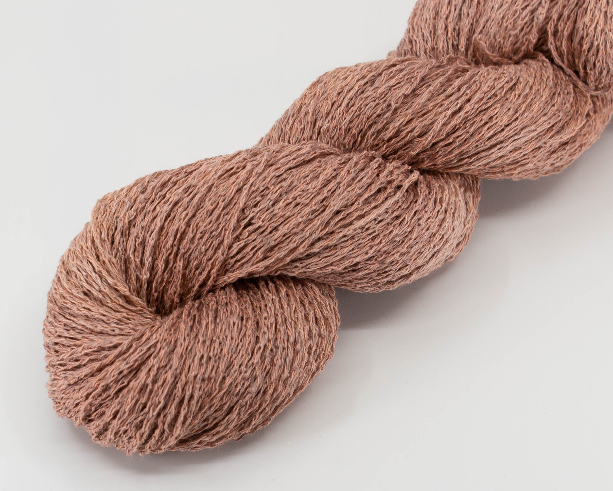 pale pink, brown linen/silk yarn, in skein