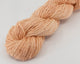 light orange fingering weight linen/silk yarn, skeined