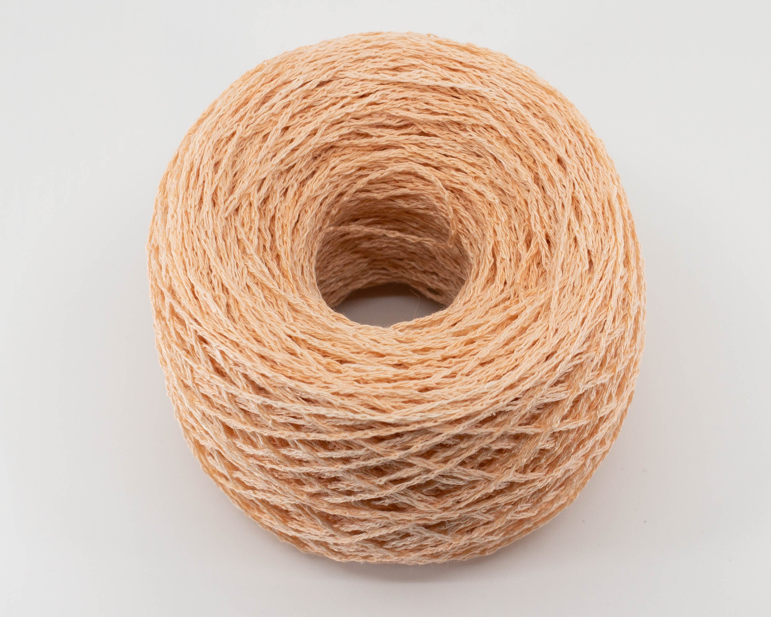light orange fingering weight linen/silk yarn, caked