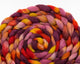 braided CVM/Cormo roving - pink, purple, yellow, orange, and red