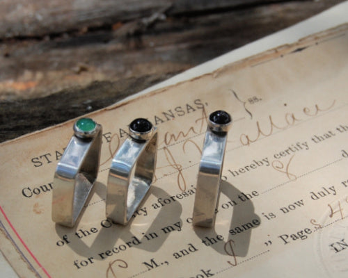 Three sterling silver square rings each with a single off centered stone by kbeau jewelry