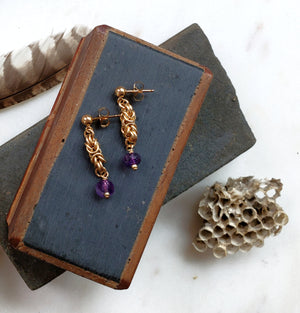 Gold earrings in byzantine pattern with amethyst drops