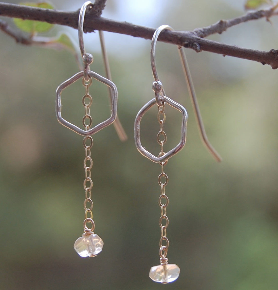 earrings of tiny hexagons with a gold chain hanging down with a bead of citrine at the end like a honey drop
