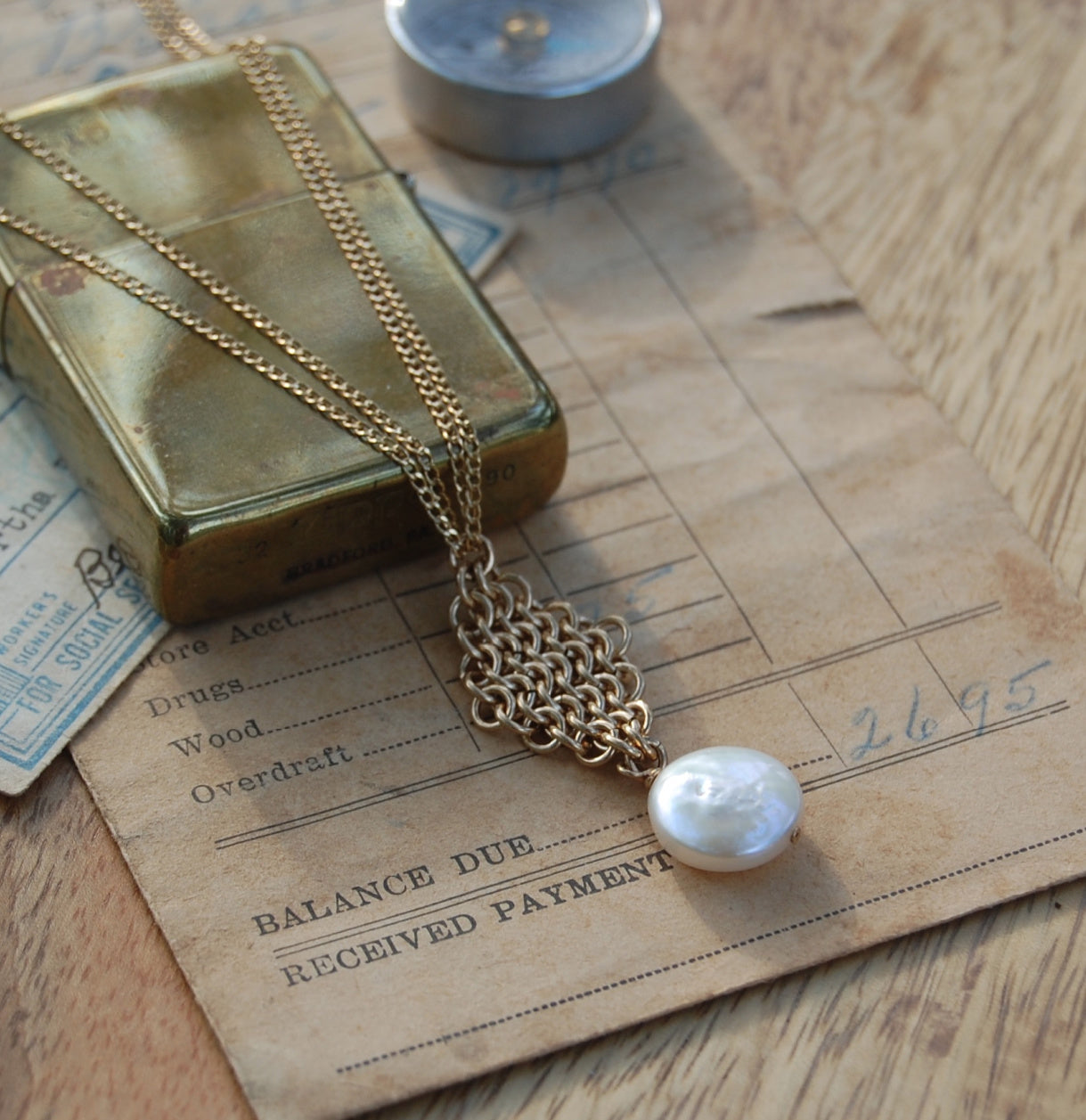 gold chain maille pendant with white coin pearl