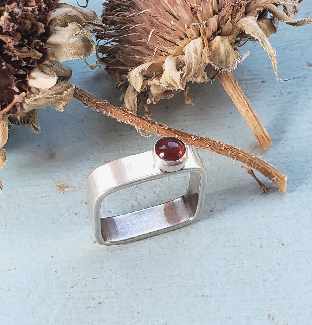 sterling silver square ring with offset carnelian cabochon