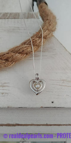ATTRACTION - Oyster Opening with Sterling Silver Cage Necklace