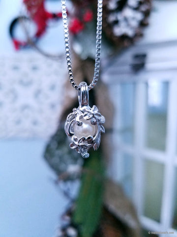 BEAUTY - Oyster Opening with Sterling Silver Cage Necklace