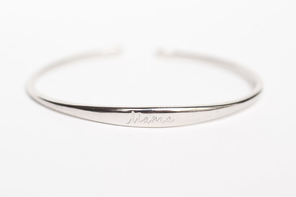 Sterling Silver cuff bracelet to remind a mother which side she last fed her baby on. The word Mama is engraved on top of the bracelet.