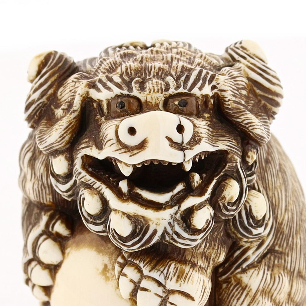 Foo Dog holding a pearl