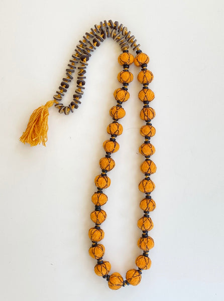 Orange beads with brown thread