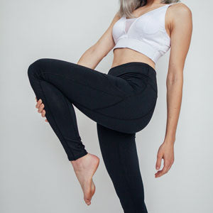woman legs black leggings