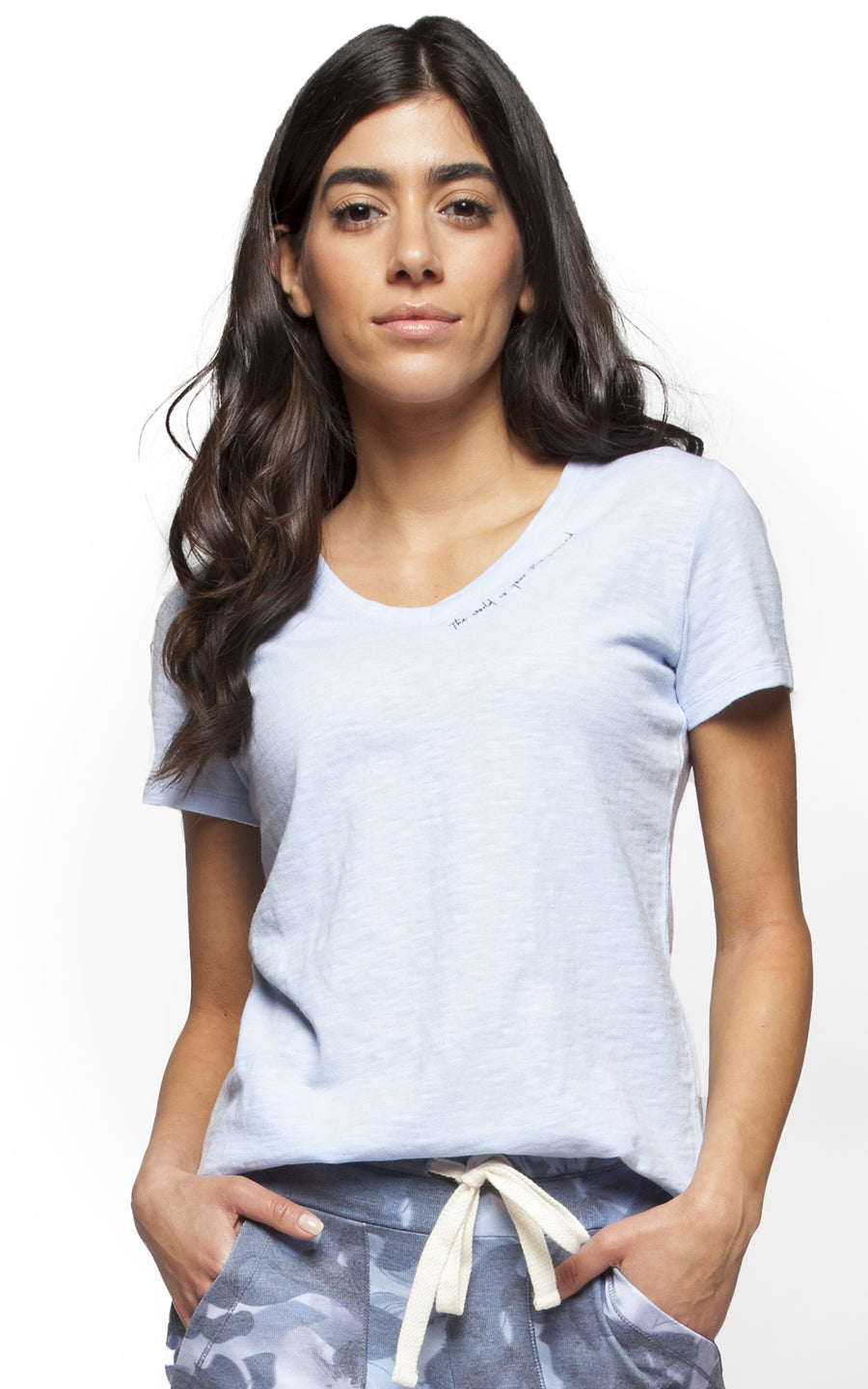 detail of v-neck tee shirt with graphic printed along neckline