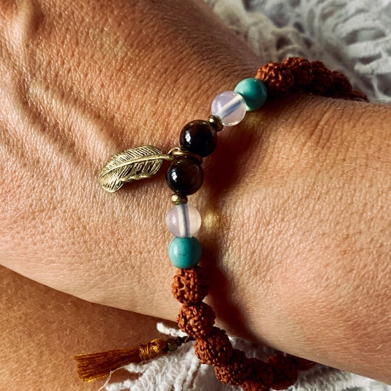 Feather wrist Mala Beads yoga bracelet, rudraksha, turquoise, quartz, tigers eye