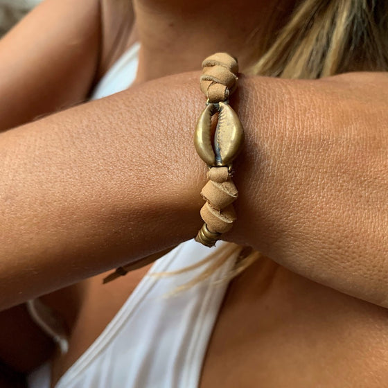 brass cowrie shell charm bracelet on suede leather