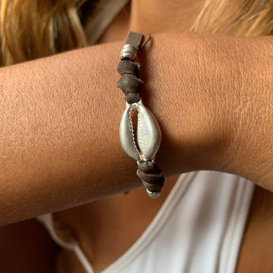 silver cowrie shell charm bracelet on suede leather