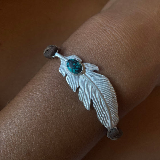Turquoise & Silver Feather charm bracelet on suede leather