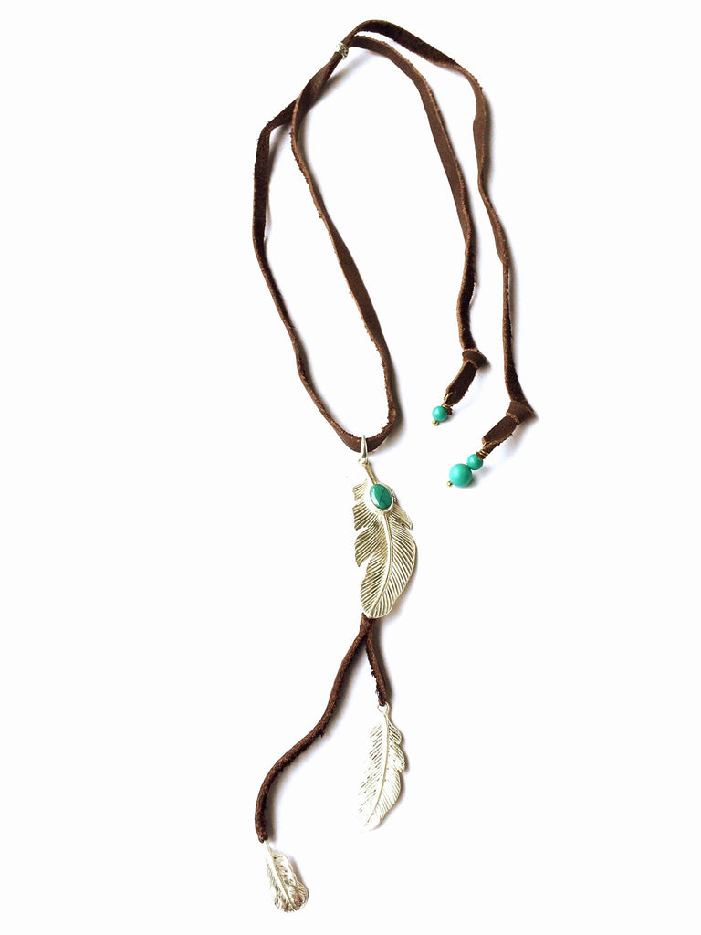This gorgeous Triple Feather necklace is hand crafted with sterling silver Eagle Feather charms on hand cut suede leather with Turquoise stones