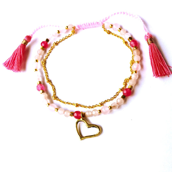 This gorgeous Heart charm bracelet is made with loving intention from healing gemstones of Rhodochrosite, Rose Quartz, Ruby Quartz & Pink Tourmaline... deliciously loving & nurturing stones for the heart. This beautiful bracelet features a hand crafted brass Heart charm and a slim brass chain to add a touch of feminine elegance & will fit most adult wrists by pulling the cotton tassels to adjust size.