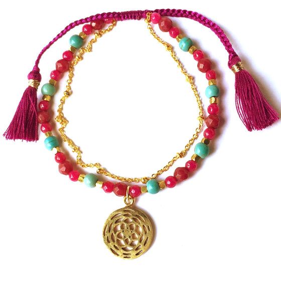 This gorgeous Rose Of Venus sacred geometry charm bracelet is made with loving intention from healing gemstones of Turquoise, Ruby Quartz. Featuring a hand crafted brass lotus charm and a slim brass chain to add a touch of feminine elegance