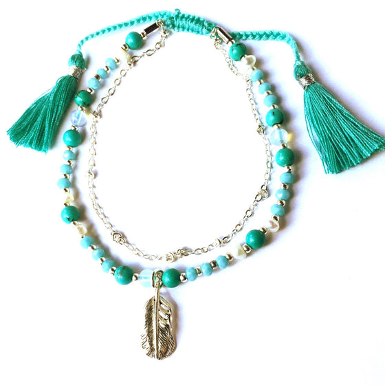 This gorgeous Feather charm bracelet is made with loving intention from healing gemstones of Turquoise, Pearl & Moonstone. Featuring a hand crafted sterling silver plated Feather charm