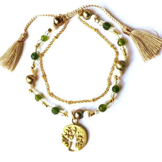 This gorgeous Tree Of Life charm yoga bracelet is made with loving intention from healing gemstones of Green Agate, Tourmaline & Pearl. Featuring a hand crafted brass Tree Of Life charm