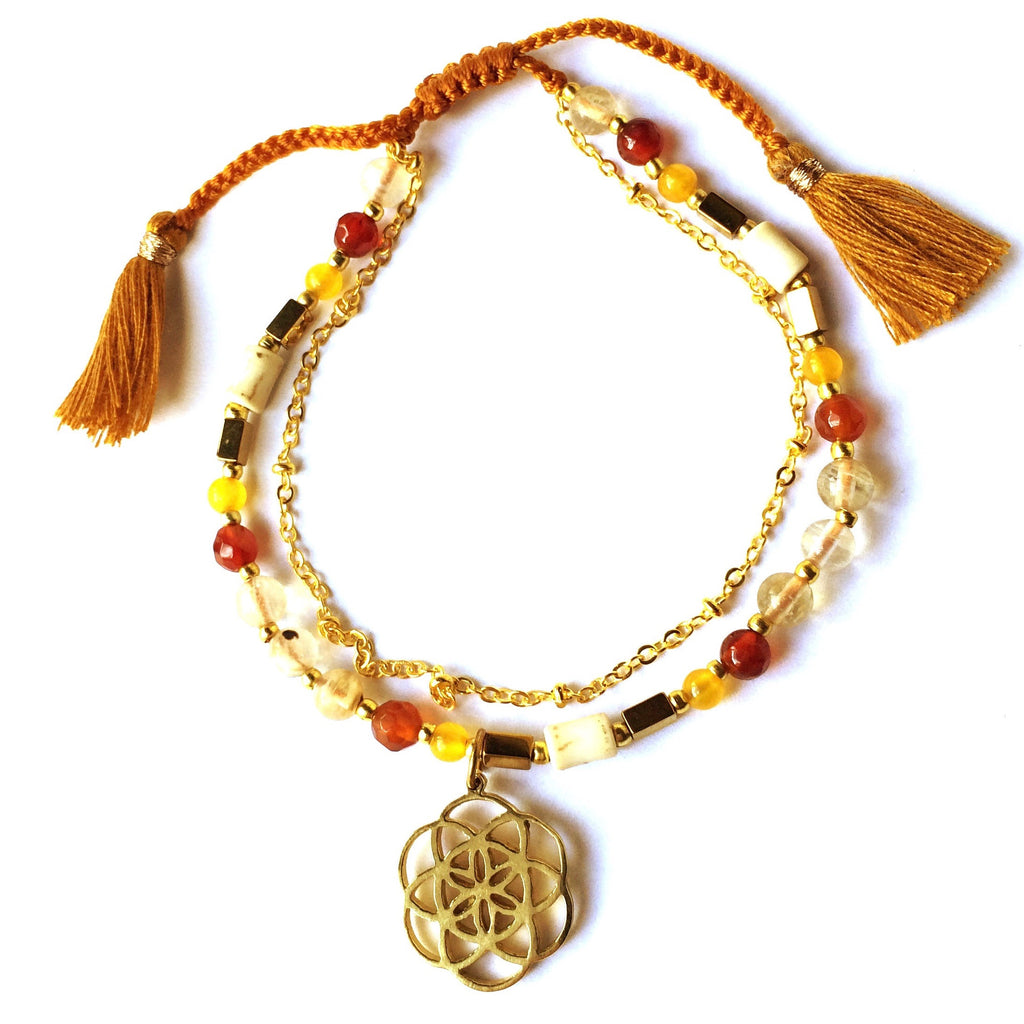 This gorgeous Seed Of Life yoga charm bracelet is made with loving intention from healing gemstones of Carnelian Agate, Citrine, Topaz. Featuring a hand crafted brass Seed Of Life sacred geometry charm
