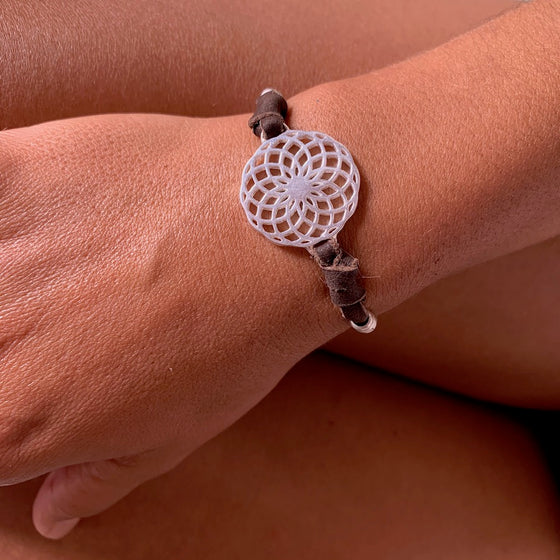 silver Sunflower Sacred Geometry charm bracelet on suede leather
