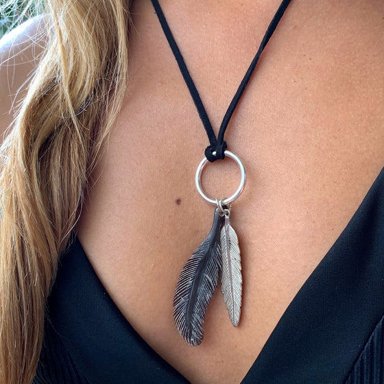 Silver Feather charm and carved Feather pendant on leather Necklace