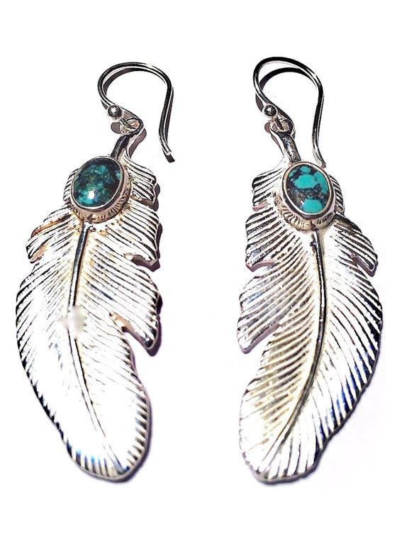 These beautiful Eagle Feather Earrings are Sterling Silver plated with Turquoise stones, 5cm long and have Sterling Silver earring hooks.