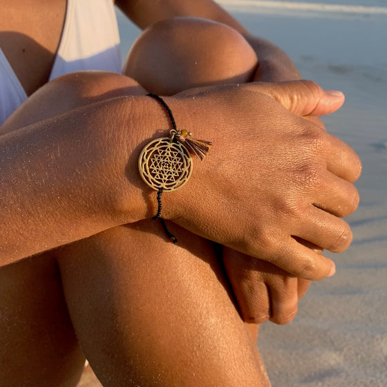 brass Sri Yantra charm bracelet with tigers eye