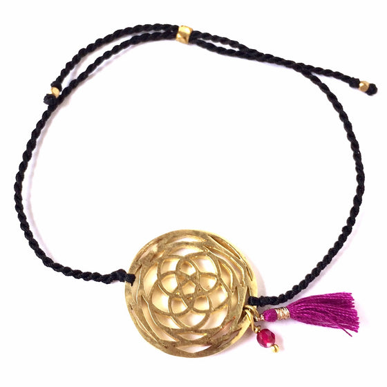 This gorgeous boho chic bracelet is hand crafted featuring a brass Rose Of Venus sacred geometry charm and a Ruby Quartz gemstone. There's a small stylish hand made ruby coloured cotton tassel hanging next to the gemstone