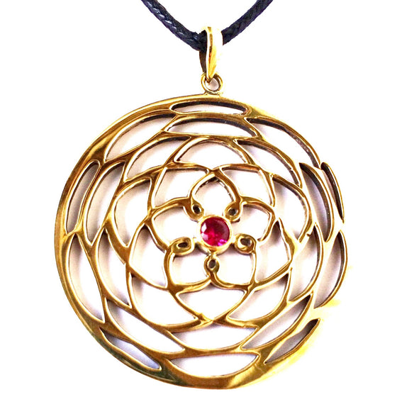 This Sacred Charm is a beautiful brass Rose Of Venus pendant, 4cm long with a Ruby Quartz centre stone