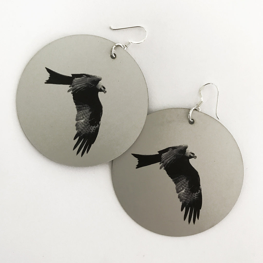 Anganpipi (Whistling Kite) Disk Earrings by Mathias Sambono