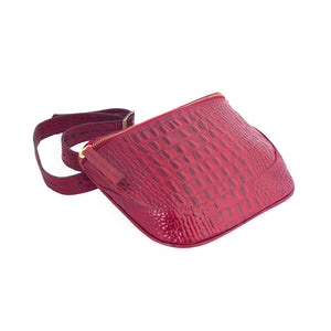belt bags; belted leather fanny pack, crocodile leather belt bag; designer belt bags and fanny packs for women