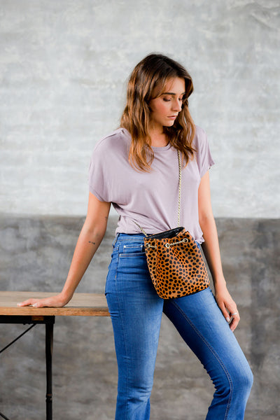 leopard drawstring purse; leopard calf hair bag; drawstring bag; sezane hope bag; calf hair purse; leather drawstring bag; bags and purses; handbag for women; affordable leather bags