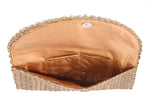 Inside view light brown lighting cowrie shell clutch women bag